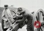 Image of US Army soldier shows cannon to woman United States USA, 1916, second 23 stock footage video 65675022633