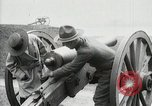 Image of US Army soldier shows cannon to woman United States USA, 1916, second 26 stock footage video 65675022633