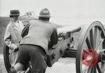 Image of US Army soldier shows cannon to woman United States USA, 1916, second 28 stock footage video 65675022633