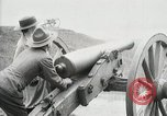 Image of US Army soldier shows cannon to woman United States USA, 1916, second 33 stock footage video 65675022633