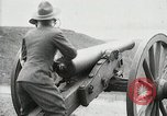 Image of US Army soldier shows cannon to woman United States USA, 1916, second 39 stock footage video 65675022633