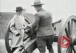 Image of US Army soldier shows cannon to woman United States USA, 1916, second 41 stock footage video 65675022633