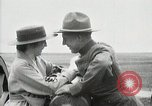 Image of US Army soldier shows cannon to woman United States USA, 1916, second 42 stock footage video 65675022633