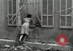 Image of French people dig in rubble Aix-en-Provence France, 1944, second 6 stock footage video 65675022698