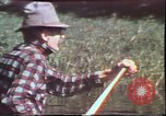 Image of Birch tree Canoe United States USA, 1975, second 13 stock footage video 65675022754