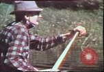 Image of Birch tree Canoe United States USA, 1975, second 15 stock footage video 65675022754