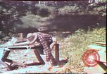 Image of Birch tree Canoe United States USA, 1975, second 42 stock footage video 65675022754