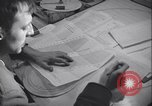 Image of men prepare weather data sheet Sierra Greenland, 1954, second 20 stock footage video 65675022805