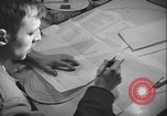 Image of men prepare weather data sheet Sierra Greenland, 1954, second 22 stock footage video 65675022805