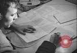 Image of men prepare weather data sheet Sierra Greenland, 1954, second 23 stock footage video 65675022805