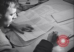 Image of men prepare weather data sheet Sierra Greenland, 1954, second 24 stock footage video 65675022805