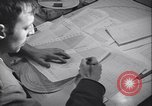 Image of men prepare weather data sheet Sierra Greenland, 1954, second 25 stock footage video 65675022805