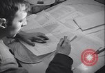 Image of men prepare weather data sheet Sierra Greenland, 1954, second 26 stock footage video 65675022805