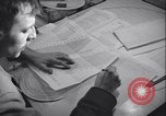 Image of men prepare weather data sheet Sierra Greenland, 1954, second 30 stock footage video 65675022805