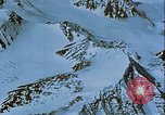 Image of Snow covered mountain peaks Arctic Region, 1954, second 36 stock footage video 65675022827