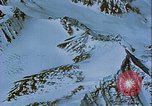 Image of Snow covered mountain peaks Arctic Region, 1954, second 37 stock footage video 65675022827