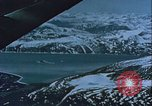 Image of Snow covered mountain peaks Arctic Region, 1954, second 39 stock footage video 65675022827