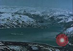 Image of Snow covered mountain peaks Arctic Region, 1954, second 49 stock footage video 65675022827