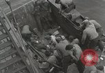 Image of Wounded US Marines brought aboard USS Mount McKinley AGC-7 Peleliu Palau Islands, 1944, second 30 stock footage video 65675022862