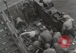 Image of Wounded US Marines brought aboard USS Mount McKinley AGC-7 Peleliu Palau Islands, 1944, second 31 stock footage video 65675022862