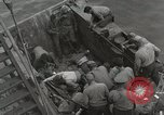 Image of Wounded US Marines brought aboard USS Mount McKinley AGC-7 Peleliu Palau Islands, 1944, second 32 stock footage video 65675022862