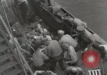 Image of Wounded US Marines brought aboard USS Mount McKinley AGC-7 Peleliu Palau Islands, 1944, second 34 stock footage video 65675022862