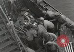 Image of Wounded US Marines brought aboard USS Mount McKinley AGC-7 Peleliu Palau Islands, 1944, second 35 stock footage video 65675022862