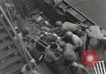 Image of Wounded US Marines brought aboard USS Mount McKinley AGC-7 Peleliu Palau Islands, 1944, second 37 stock footage video 65675022862