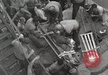 Image of Wounded US Marines brought aboard USS Mount McKinley AGC-7 Peleliu Palau Islands, 1944, second 43 stock footage video 65675022862