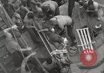 Image of Wounded US Marines brought aboard USS Mount McKinley AGC-7 Peleliu Palau Islands, 1944, second 44 stock footage video 65675022862