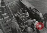 Image of Wounded US Marines brought aboard USS Mount McKinley AGC-7 Peleliu Palau Islands, 1944, second 55 stock footage video 65675022862