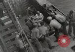 Image of Wounded US Marines brought aboard USS Mount McKinley AGC-7 Peleliu Palau Islands, 1944, second 57 stock footage video 65675022862