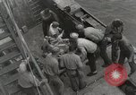Image of Wounded US Marines brought aboard USS Mount McKinley AGC-7 Peleliu Palau Islands, 1944, second 58 stock footage video 65675022862