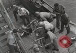 Image of Wounded US Marines brought aboard USS Mount McKinley AGC-7 Peleliu Palau Islands, 1944, second 61 stock footage video 65675022862