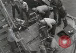 Image of Wounded US Marines brought aboard USS Mount McKinley AGC-7 Peleliu Palau Islands, 1944, second 62 stock footage video 65675022862
