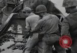 Image of 81st Army Division firing on sniper Peleliu Palau Islands, 1944, second 29 stock footage video 65675022967