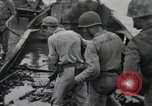 Image of 81st Army Division firing on sniper Peleliu Palau Islands, 1944, second 30 stock footage video 65675022967