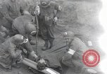 Image of Medics tend to wounded U.S. soldiers on beach Normandy France, 1944, second 1 stock footage video 65675022977