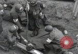Image of Medics tend to wounded U.S. soldiers on beach Normandy France, 1944, second 3 stock footage video 65675022977