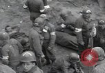 Image of Medics tend to wounded U.S. soldiers on beach Normandy France, 1944, second 5 stock footage video 65675022977