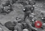 Image of Medics tend to wounded U.S. soldiers on beach Normandy France, 1944, second 6 stock footage video 65675022977