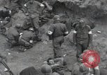 Image of Medics tend to wounded U.S. soldiers on beach Normandy France, 1944, second 7 stock footage video 65675022977