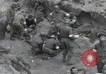 Image of Medics tend to wounded U.S. soldiers on beach Normandy France, 1944, second 8 stock footage video 65675022977