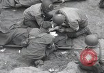 Image of Medics tend to wounded U.S. soldiers on beach Normandy France, 1944, second 13 stock footage video 65675022977