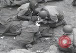 Image of Medics tend to wounded U.S. soldiers on beach Normandy France, 1944, second 14 stock footage video 65675022977