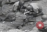 Image of Medics tend to wounded U.S. soldiers on beach Normandy France, 1944, second 16 stock footage video 65675022977