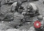 Image of Medics tend to wounded U.S. soldiers on beach Normandy France, 1944, second 17 stock footage video 65675022977