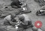 Image of Medics tend to wounded U.S. soldiers on beach Normandy France, 1944, second 20 stock footage video 65675022977