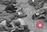 Image of Medics tend to wounded U.S. soldiers on beach Normandy France, 1944, second 21 stock footage video 65675022977
