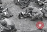 Image of Medics tend to wounded U.S. soldiers on beach Normandy France, 1944, second 22 stock footage video 65675022977